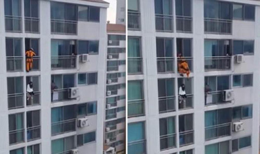 Un bombero surcoreano realizó un espectacular acrobacia para salvar a una joven que amenazaba con suicidarse.