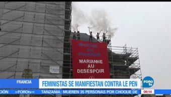 grupo de feministas, manifestaron, alto de una iglesia, Marine Le Pen