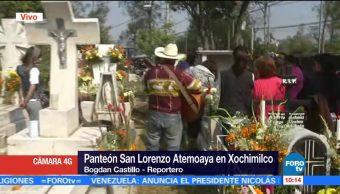 Músicos, visitantes y flores llenan el panteón San Lorenzo Atemoaya de Xochimilco