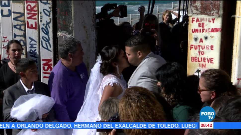 Se casan a pesar del muro fronterizo