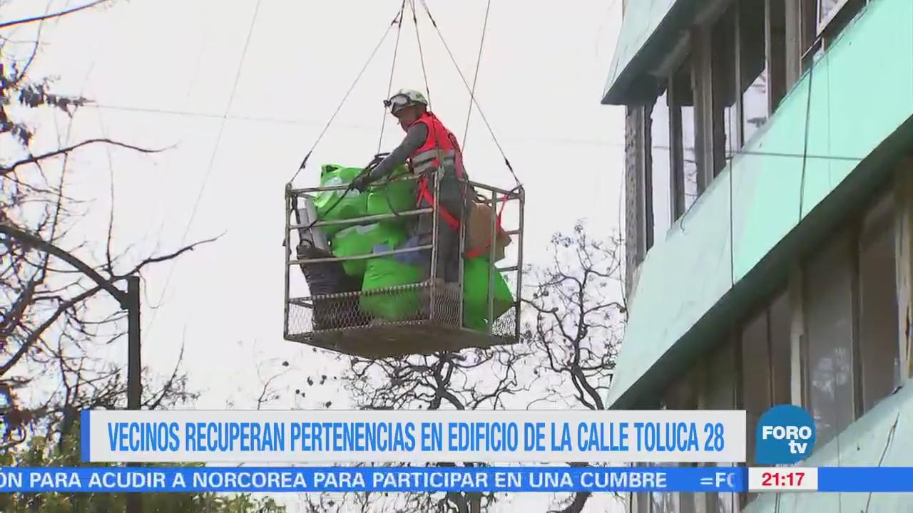 Vecinos recuperan pertenencias en edificio de la calle Toluca 28