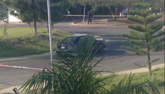 Hallan cinco cuerpos en un auto abandonado en Michoacán