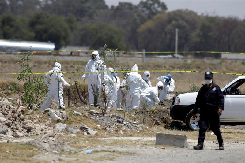 Foto: Los cuerpos corresponden a 7 hombres y una mujer, el 30 de marzo de 2019 (EFE)