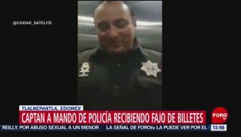 Foto: Graban a jefe policíaco de Tlalnepantla recibiendo fajo de billetes