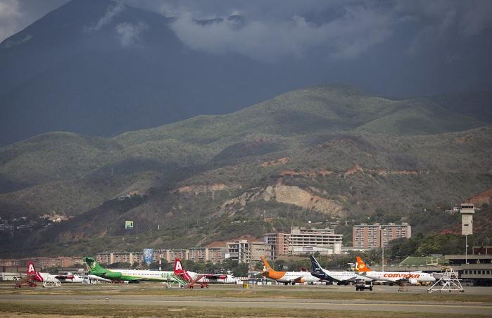 Foto: Aviones parados en una pista en el aeropuerto Simón Bolívar en Caracas, Venezuela. El 12 de julio de 2015