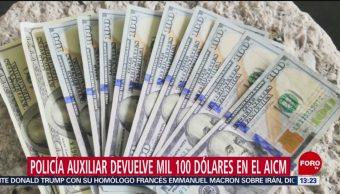 FOTO: Policía auxiliar devuelve mil 100 dólares en el AICM, 21 Julio 2019