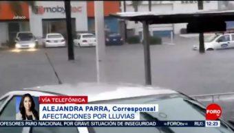 Buscan a 2 desaparecidos por temporal de lluvias en Jalisco