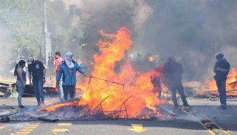 Imagen: Los decesos se produjeron después del toque de queda luego de que el supermercado fuera saqueado