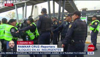 Manifestantes realizan bloqueo en Insurgentes, cerca de Periférico Sur