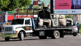 Retiran vehiculos incendiado en Culiacán, Sinaloa.