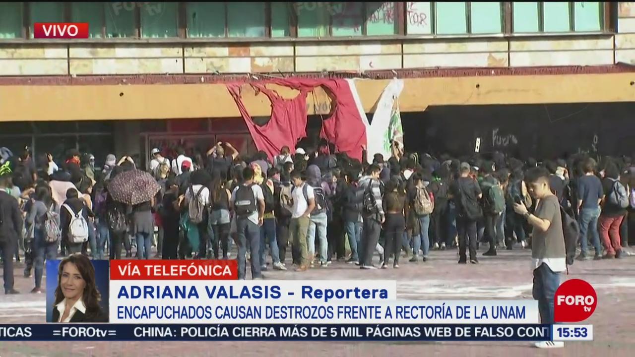 FOTO: Encapuchados queman Bandera México Rectoría UNAM