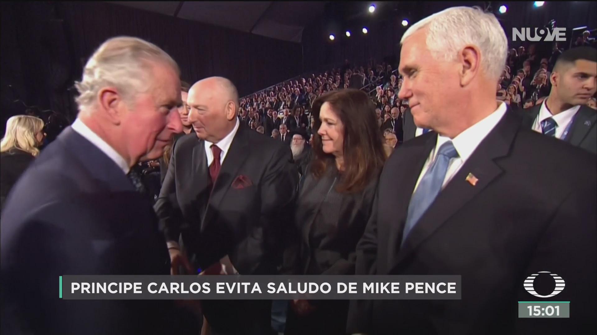 FOTO: principe carlos evita saludo de mike pence