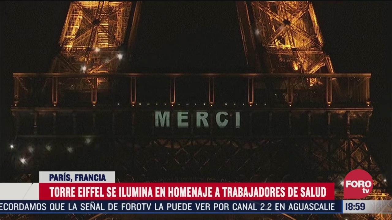 FOTO: iluminan torre eiffel para agradecer a medicos por coronavirus
