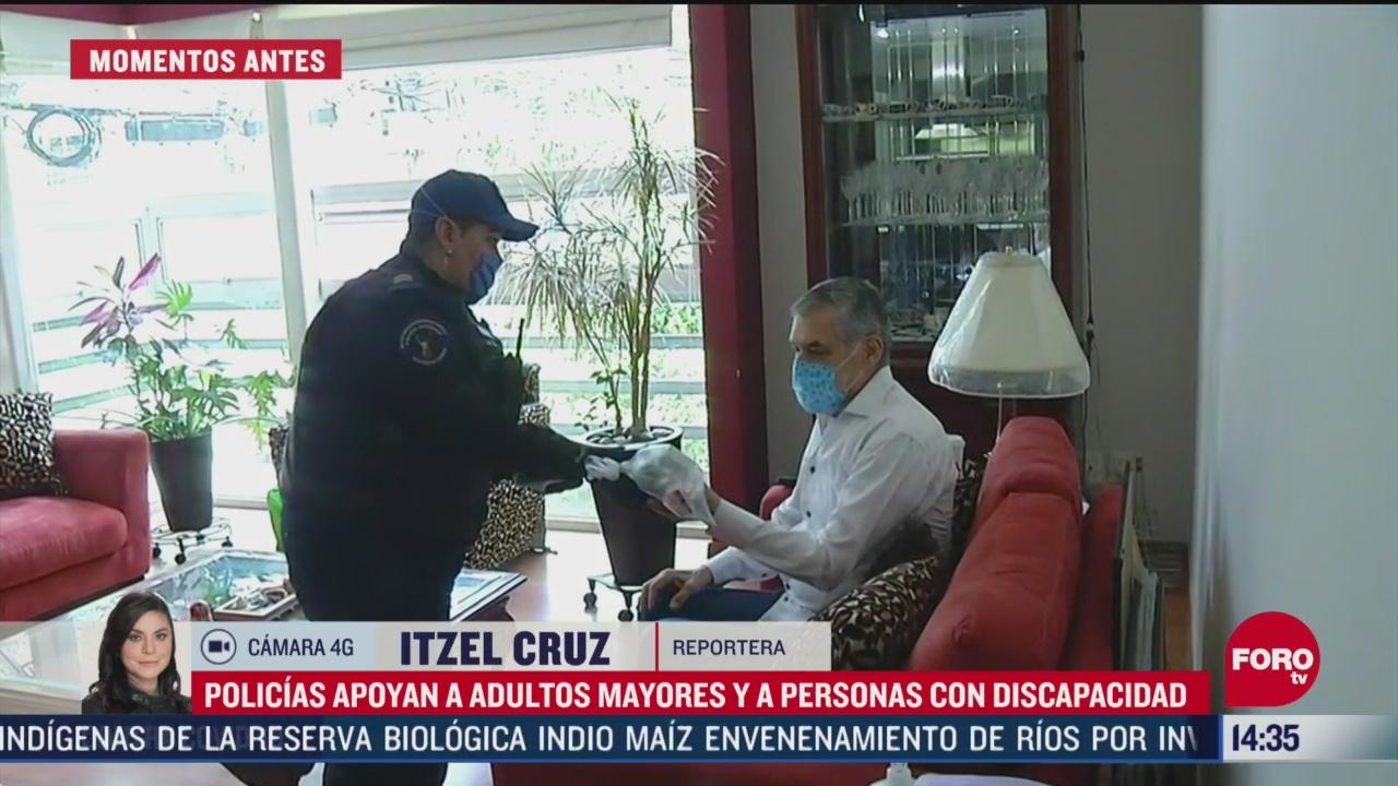 FOTO: policias de benito juarez cdmx apoyan a adultos mayores a realizar sus compras por el coronavirus