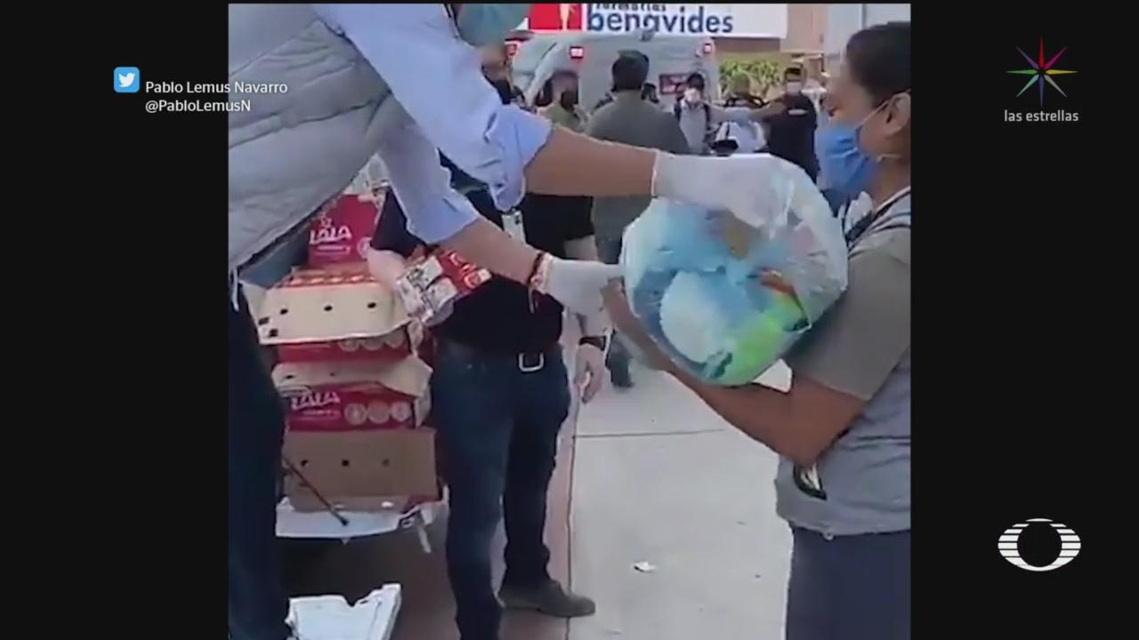 FOTO: 1 de mayo 2020, ayuntamiento de zapopan jalisco reparte despensas a ciudadanos