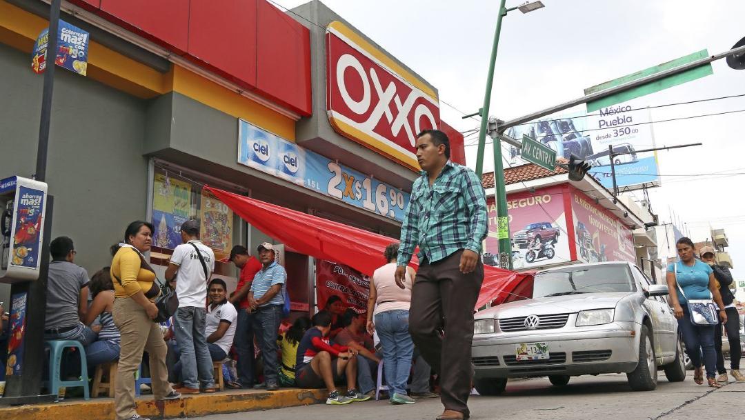 Foto: Femsa, dueña de OXXO, pagará al SAT ocho mil 790 millones de pesos, 28 de mayo de 2020, (Cuartoscuro, archivo)