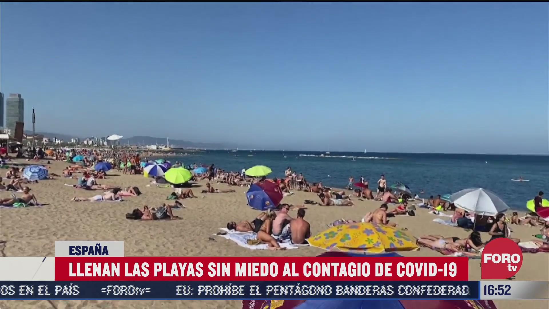 FOTO: 19 de julio 2020, habitantes de barcelona acuden de forma masiva a la playa