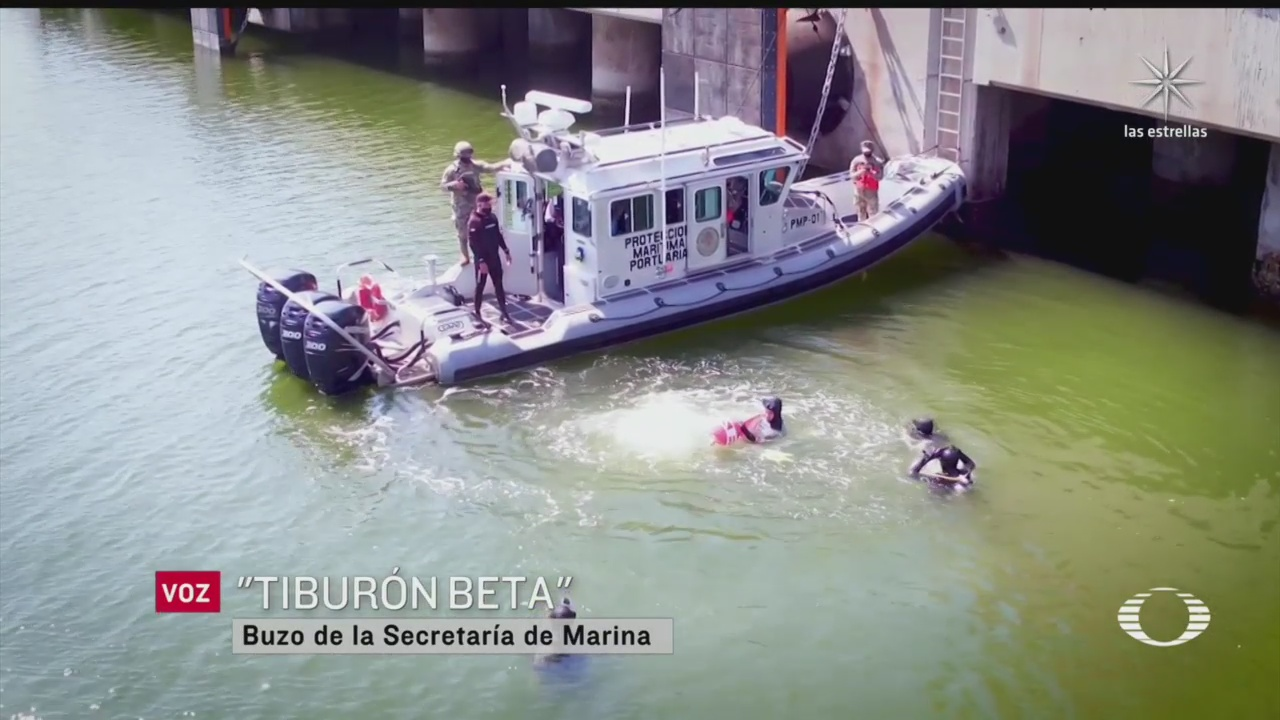 buzos de la marina detectan droga que viaja bajo el agua