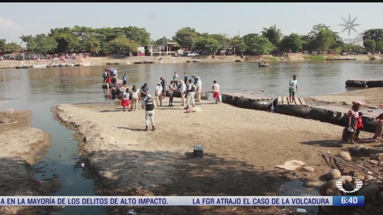 pequenos grupos de migrantes hondurenos siguen llegando a guatemala