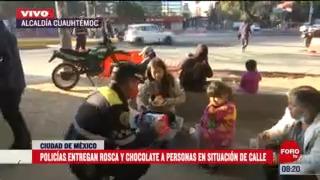 policias entregan rosca y chocolate a personas en situacion de calle en cdmx
