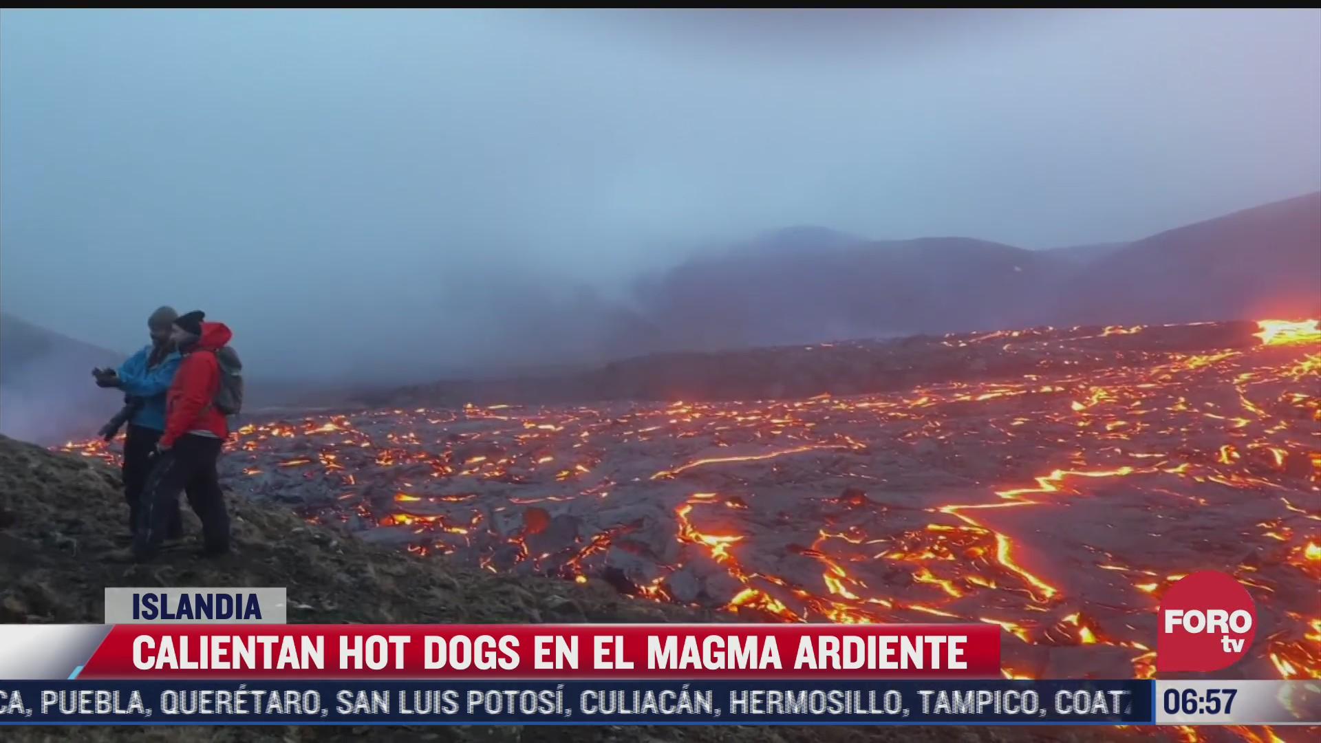 geologos calientan hot dogs en magma ardiente de un volcan