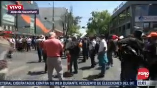 Transportistas de la RTP bloquen el Eje Central en la Ciudad de México