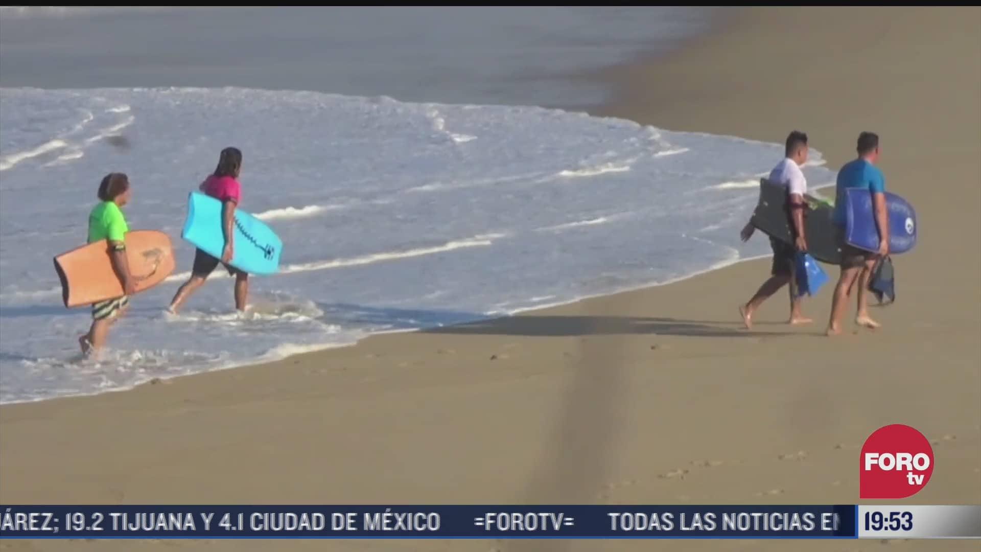 realizan torneo de surf con publico presencial en puerto escondido