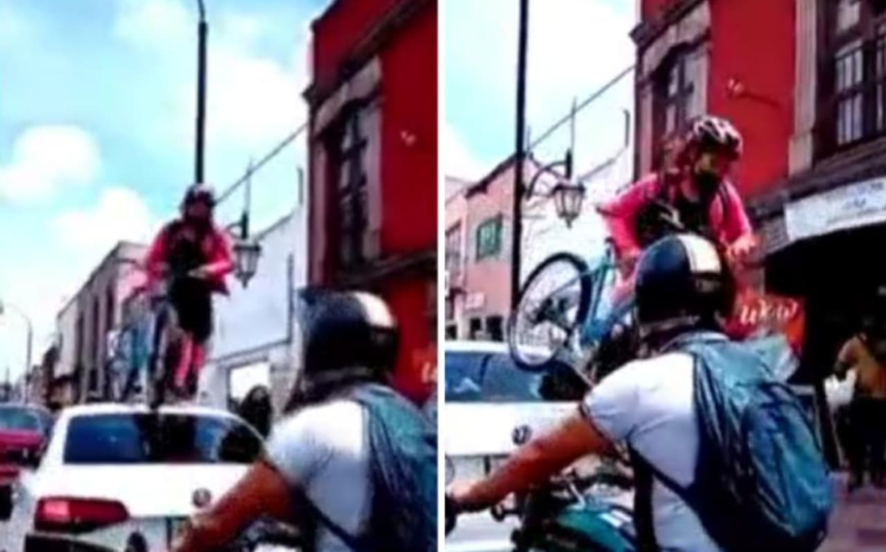 Ciclista pasa bici por encima de auto sobre ciclovía: Video