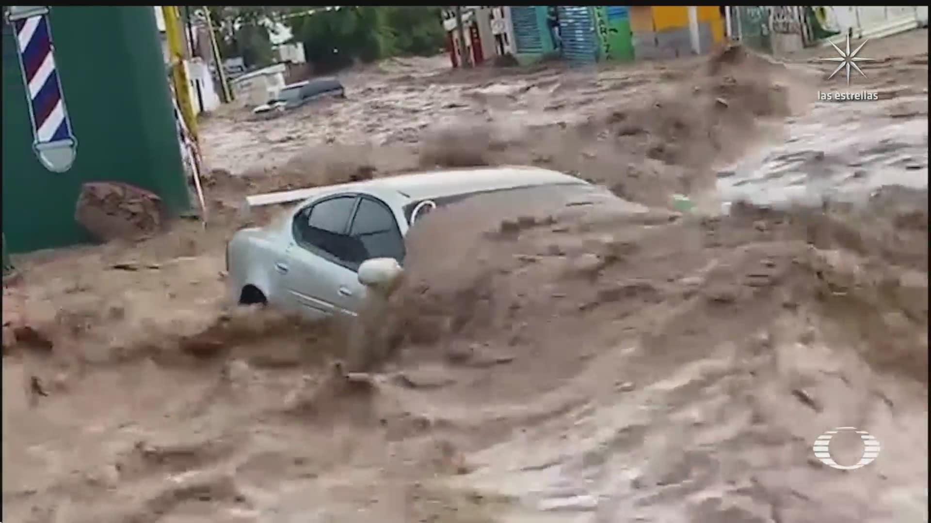 lluvias anegan nogales sonora vehiculos son arrastrados por las corrientes