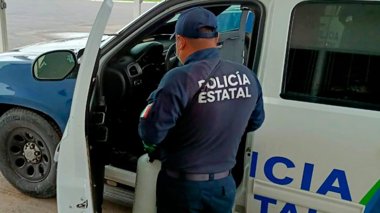 Policía de Tamaulipas en su unidad policiaca (Twitter: @SSP_GobTam)