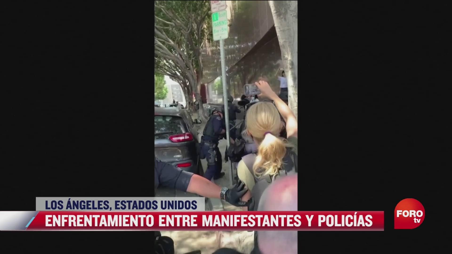 se registra enfrentamiento entre policias y manifestantes en los angeles