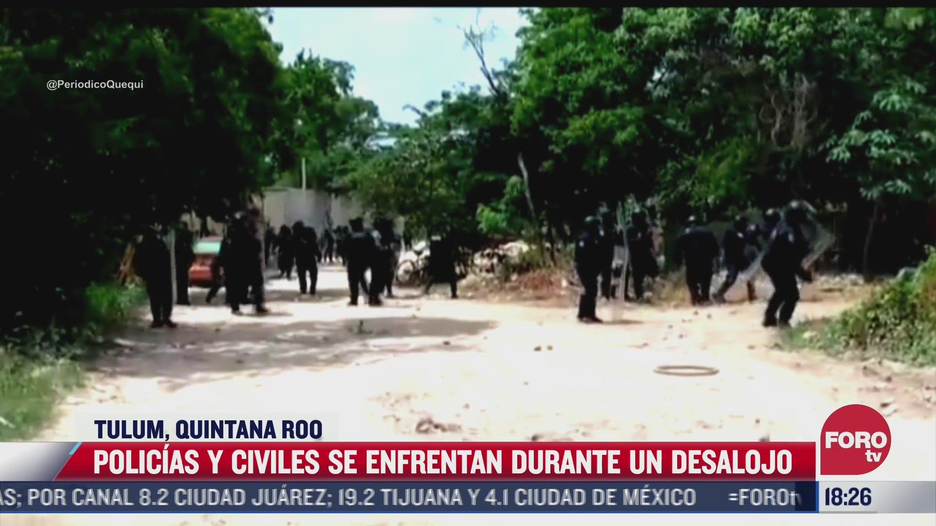 video se enfrentan civiles y policias durante un desalojo en tulum