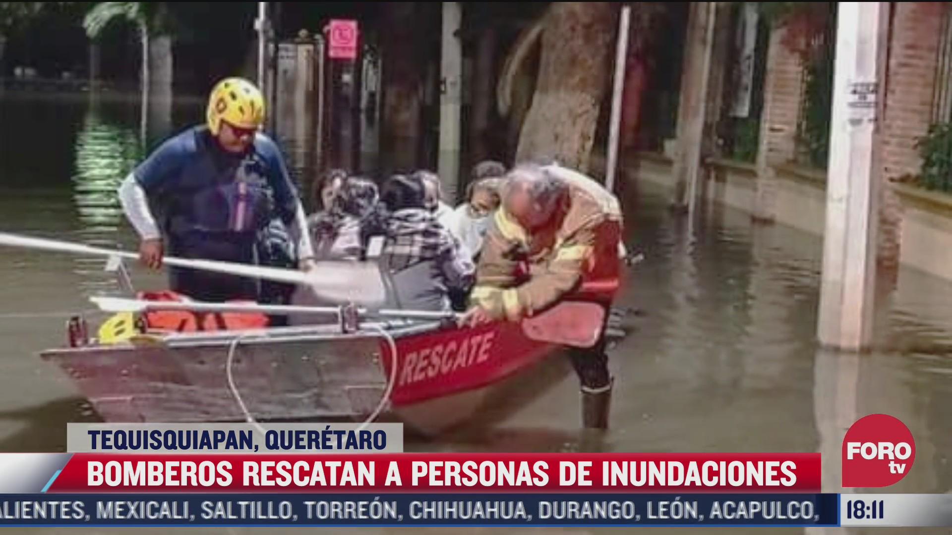 bomberos rescatan a personas de inundaciones en queretaro