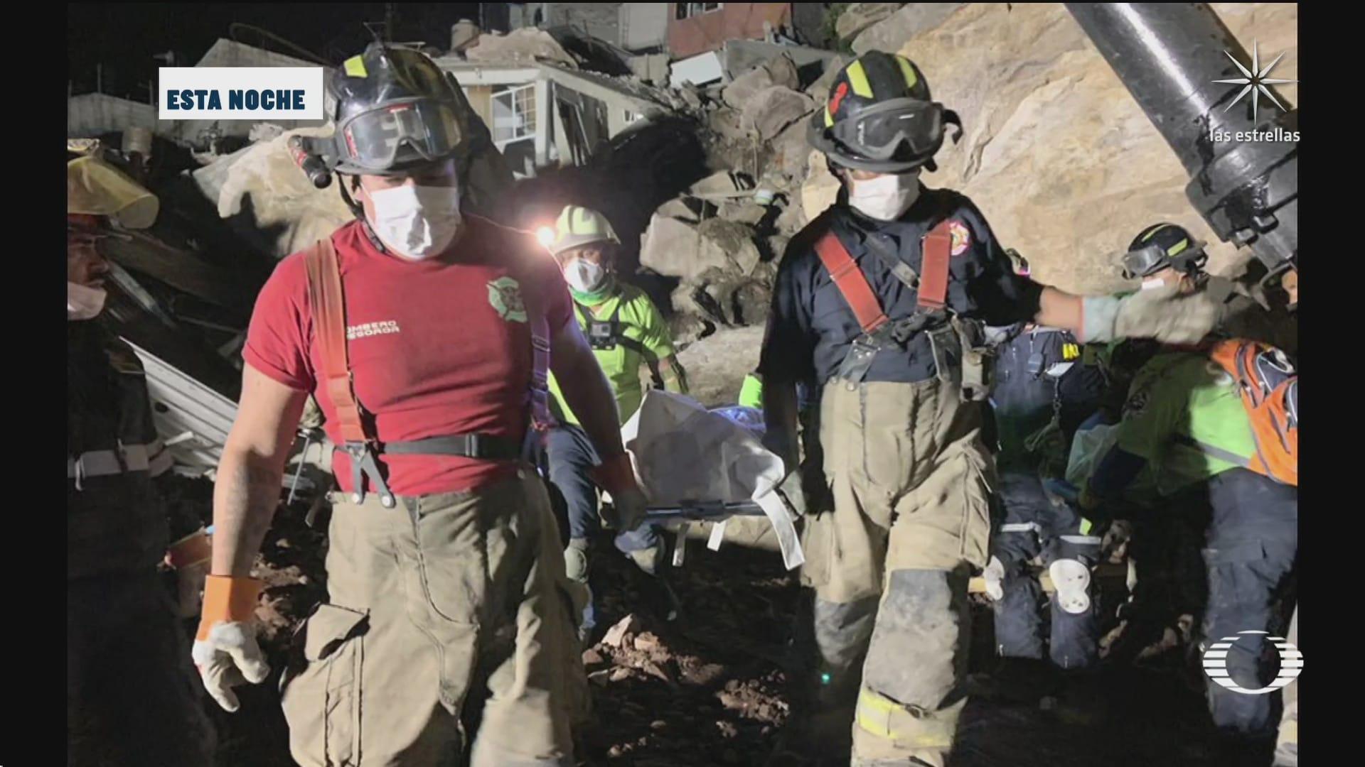 hallan los cuerpos de madre e hijo tras deslave en el chiquihuite