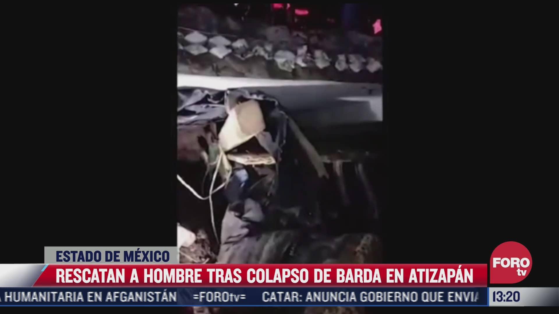 rescatan a hombre tras colapso de barda en atizapan edomex