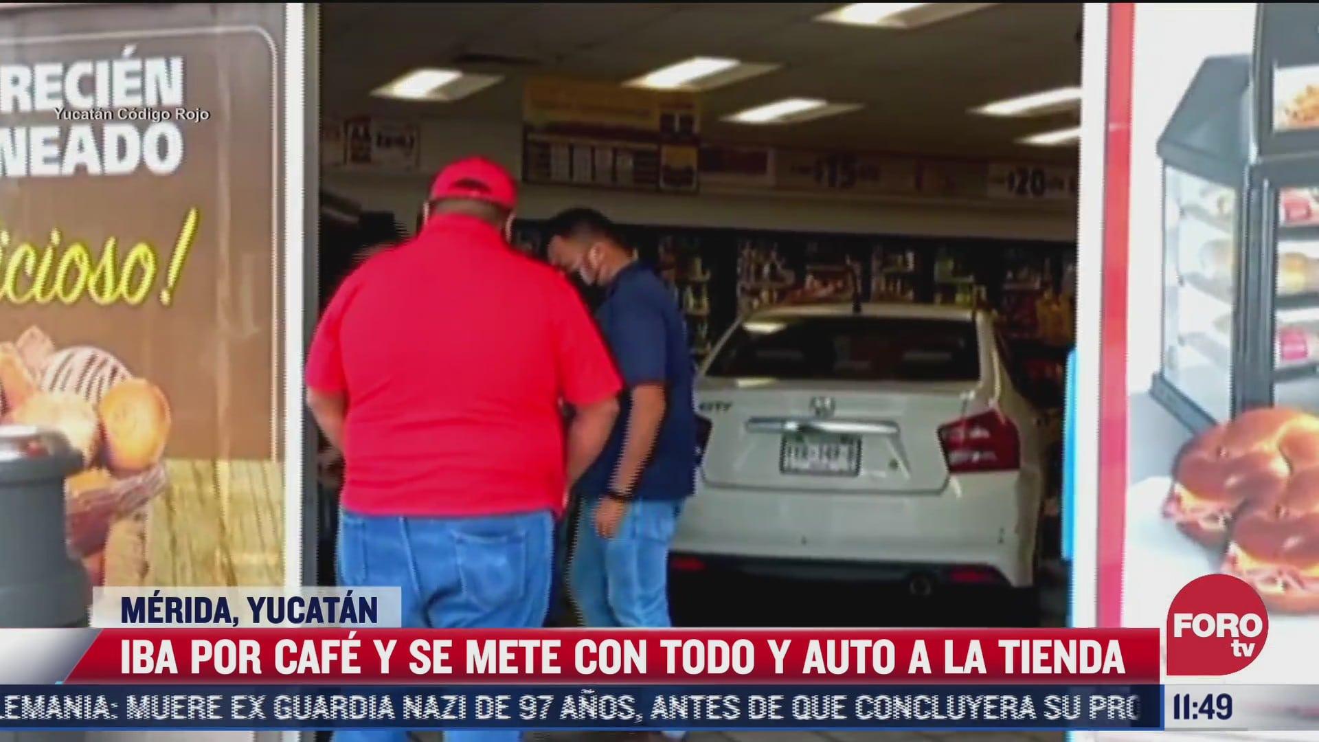 conductor entra a tienda con todo y auto
