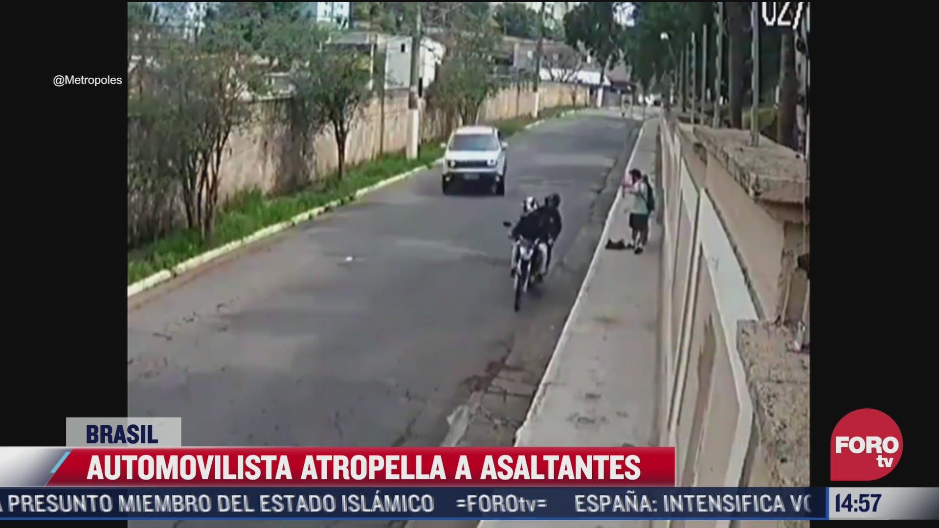 video automovilista atropella a asaltantes en brasil