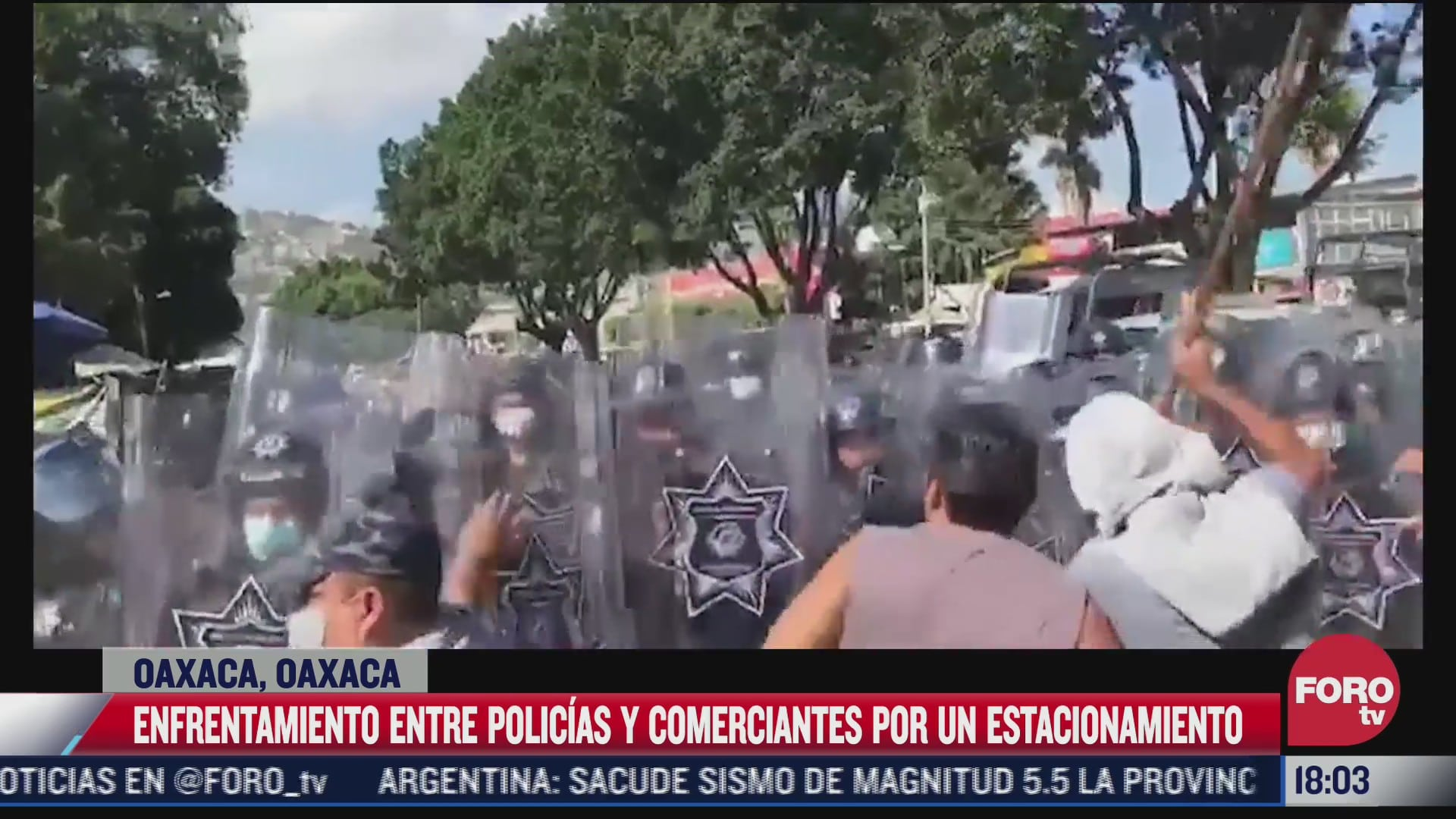 video enfrentamiento entre policias y comerciantes en oaxaca